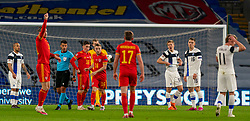 CARDIFF, WALES - Wednesday, November 18, 2020: Referee Jesús Gil Manzano shows a red card to Finland's Jere Uronen (R) during the UEFA Nations League Group Stage League B Group 4 match between Wales and Finland at the Cardiff City Stadium. Wales won 3-1 and finished top of Group 4, winning promotion to League A. (Pic by David Rawcliffe/Propaganda)