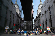 Supporters of Wikileaks founder Julian Assange protest outside London's Old Bailey court as his fight against extradition to the US has resumed, on 15th September 2020, in London, England. Assange has been in Belmarsh Prison for 16 months and is wanted over the publication of classified documents in 2010 and 2011. If convicted in the US, he faces a possible penalty of 175 years in jail.