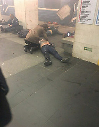 April 3, 2017 - St. Petersburg, Russia - Moments after the blast people on the ground as others rush to help injured in the subway train. At least 10 people have been killed after an explosion on the Saint Petersburg's Sennaya metro station. (Credit Image: © Russian Look via ZUMA Wire)