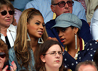 Singer Beyonce Knowles watches the womens singles final with her sister who is also a singer. Wimbledon Tennis Championship, Day 12,5/07/2003. Credit: Colorsport / Matthew Impey DIGITAL FILE ONLY