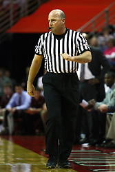12 February 2011: Referee David Maracich talks to the Redbird bench just before issuing a warning to coach Tim Jankovich during an NCAA Missouri Valley Conference basketball game between the Missouri State Bears and the Illinois State Redbirds at Redbird Arena in Normal Illinois.