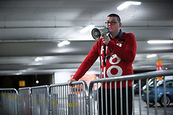 © Licensed to London News Pictures . 27/11/2015 . Salford , UK . A member of staff uses a megaphone to give instructions to people in the queue for Black Friday reductions , at a branch of Tesco in Pendleton , Salford , this morning (Friday 27th November) . Last year (2014) scuffles and fights were reported amongst queuing bargain-hunters . Photo credit: Joel Goodman/LNP