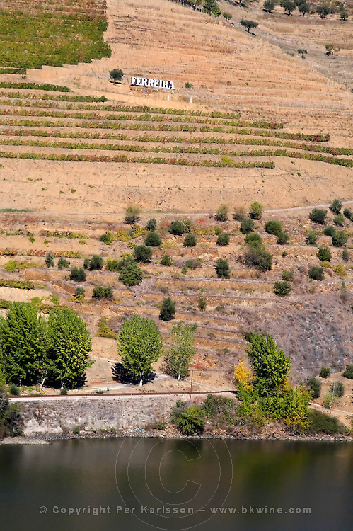 douro river and steep vineyards ferreira sign douro portugal