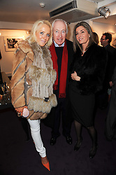 Left to right, CLARE VAN DAM, SIR JOHN BECKWITH and his partner HELENE at a private view of photographs held at the Little Black Gallery, Park Walk, London on 20th January 2010.