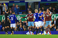 West Ham's James Tomkins holds his face despite having been pushed in the chest by Kevin Mirallas of Everton - Everton vs. West Ham United - Barclay's Premier League - Goodison Park - Liverpool - 22/11/2014 Pic Philip Oldham/Sportimage