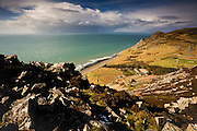 Although the image depicts a sunny and spectacularly dramatic landscape, you can see, brooding offshore, very heavy weather conditions. In strong westerly and northerly gales, the tiny village of Y Nant is remarkably vulnerable to harsh weather, sitting as it does on the most seaward edge of this wide coastal valley. Enjoy the warmth of summer, for in winter it is a different story