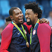 Basketball - Olympics: Day 16  Kevin Durant #5 of United States and DeAndre Jordan #6 of United States with their gold medals after the USA Vs Serbia Men's Basketball Gold Medal game at Carioca Arena1on August 21, 2016 in Rio de Janeiro, Brazil. (Photo by Tim Clayton/Corbis via Getty Images)