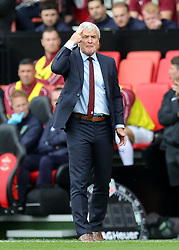 """Southampton manager Mark Hughes on the touchline during the Premier League match at St Mary's, Southampton. PRESS ASSOCIATION Photo. Picture date: Sunday August 12, 2018. See PA story SOCCER Southampton. Photo credit should read: Andrew Matthews/PA Wire. RESTRICTIONS: EDITORIAL USE ONLY No use with unauthorised audio, video, data, fixture lists, club/league logos or """"live"""" services. Online in-match use limited to 120 images, no video emulation. No use in betting, games or single club/league/player publications."""