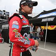 Ricky Stenhouse Jr. walks to his garage area during the first practice session of the 56th Annual NASCAR Coke Zero400 race at Daytona International Speedway on Thursday, July 3, 2014 in Daytona Beach, Florida.  (AP Photo/Alex Menendez)