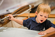 Kyle, aged 2 and a half, the fourth generation to the Drascombe boats family takes the helm on their stand - The London Boat Show opens at the Excel centre. London 06 Jan 2017