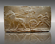 Sculpted Assyrian relief panels of Royal Chariot & Guards  from Hadatu ( Aslantas ) around 800 B.C. Istanbul Archaeological museum Inv No. 1946 If you prefer to buy from our ALAMY PHOTO LIBRARY  Collection visit : https://www.alamy.com/portfolio/paul-williams-funkystock/ancient-assyria-antiquities.html  Type -    Aslantas    - into the LOWER SEARCH WITHIN GALLERY box to refine search by adding background colour, place, museum etc<br /> <br /> Visit our ANCIENT WORLD PHOTO COLLECTIONS for more photos to download or buy as wall art prints https://funkystock.photoshelter.com/gallery-collection/Ancient-World-Art-Antiquities-Historic-Sites-Pictures-Images-of/C00006u26yqSkDOM