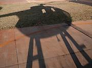 Shadow of a helicopter on helipad, Kaua'i, Hawai'i
