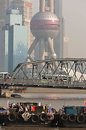 China, Shanghai. Pudong slyline and Waibadu bridge view from the Bund