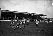 20/03/1963<br /> 03/20/1963<br /> 20 March 1963<br /> Soccer: Transport v Limerick, Cup tie replay at Harold's Cross, Dublin. Transport goalie Grogan, stumbles as he gathers the ball with Gaff of Transport on left and Limerick forward O'Brien on right.