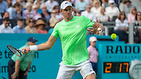 Tennis - 2019 Queen's Club Fever-Tree Championships - Day One, Monday<br /> <br /> Men's Singles, First Round: Cameron Norrie (GBR) Vs. Kevin Anderson (RSA)  <br /> <br /> Kevin Anderson (RSA) opens his body to strike the return as he marches towards victory on Centre Court.<br />  <br /> COLORSPORT/DANIEL BEARHAM