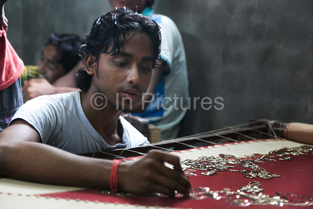 Dhaka, Bangladesh. Arman, 19, disabled in the legs working in the garment industry. he works 12 hours / day 7 days/week and makes T1000.00 ( £8.50) per week. He gives his family 800 and keeps the rest. CSID put him trough the 1 year training which is now enabling him to be independent.  The Stars Foundation visiting CSID.Centre for Services and Information on Disability (CSID) is a charity working for integrating disabled children into mainstream society.