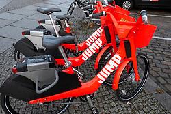 Jump electric rental bicycles on street in Berlin, Germany