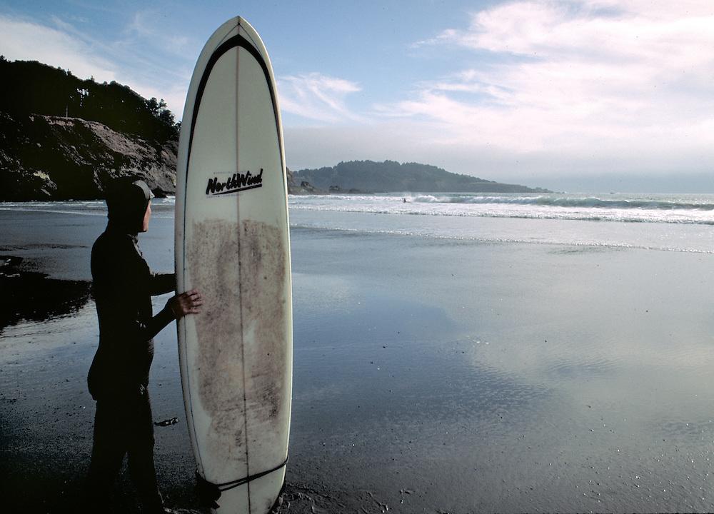 Surfer at Big River Beach, Mendocino, California.  CD scan from 35 mm film.