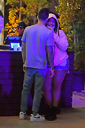 EXCLUSIVE: Jordyn Woods gets close to a mystery man as she has a drink at a bar at the Coachella music festival . Jordyn was seen wearing a facemask and glasses at one point before enjoying a drink at the bar. Her mystery man stayed very close and put his arm around her as they chatted with a friend. 12 Apr 2019 Pictured: Jordyn woods. Photo credit: Marksman/ Snorlax / MEGA TheMegaAgency.com +1 888 505 6342