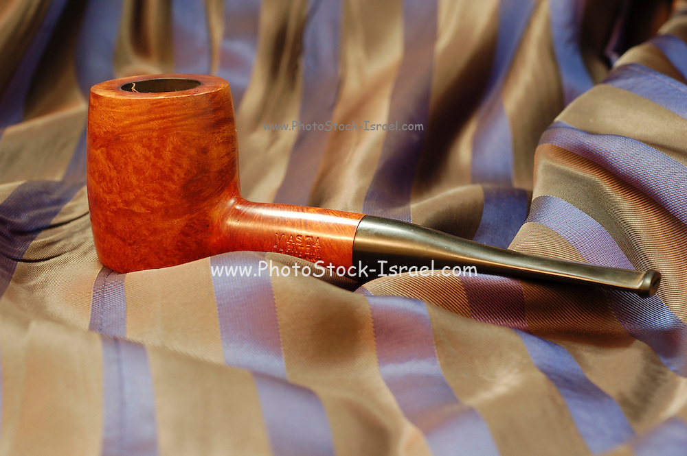 still life, Old wooden pipe on fabric background