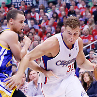 21 April 2014: Los Angeles Clippers forward Blake Griffin (32) drives past Golden State Warriors guard Stephen Curry (30) during the Los Angeles Clippers 138-98 victory over the Golden State Warriors, during Game Two of the Western Conference Quarterfinals of the NBA Playoffs, at the Staples Center, Los Angeles, California, USA.