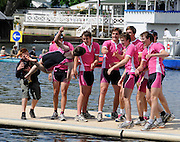 Henley, GREAT BRITAIN,  2012 Henley Royal Regatta. The crew from Abingdon School, celebrate, by tossing the Cox in the water, after winning, the Princess Elizabeth Challenge Cup. Sunday  15:15:01  01/07/2012 [Mandatory Credit, Intersport-images] ..Rowing Courses, Henley Reach, Henley, ENGLAND . HRR.