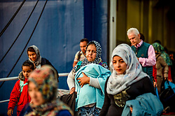 Refugees and migrants arrive, from Moria camp in Lesvos, at the port of Piraeus near Athens, Greece, on November 12, 2019<br /> <br /> Pictured: <br /> Dimitris Lampropoulos    EEm date