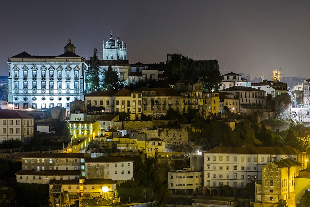 Panoramic views of Oporto Old town from Sam Luis Bridge by night. Oporto, Portugal