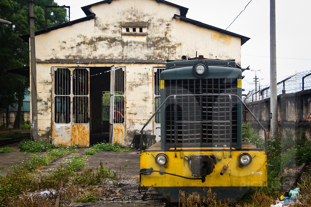 An old Russian engine outside a workshop in the Railway Worker's Khu Tap The, Hanoi, Vietnam, Asia