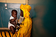 Senegal, May 2009. A mother and her two children wait outside the Thies Lab.