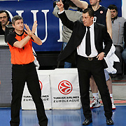 Anadolu Efes's coach Ufuk Sarica (R) during their Turkish Airlines Euroleague Basketball Top 16 Group E Game 4 match Anadolu Efes between Olympiacos at Sinan Erdem Arena in Istanbul, Turkey, Wednesday, February 08, 2012. Photo by TURKPIX