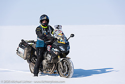 Alessandro Ciceri, known for his cold weather riding and as Wizz on social media (@wizz_inwiaggio), after riding 6,200 mile (10,000 km) from his home in Italy in the middle of winter and after racing on the mile long ice track. Here he is just before leaving to ride another 3,100 miles (5,000 Km) through Siberia in winter to Vladivostok as he says goodbye to Lake Baikal after the Baikal Mile Ice Speed Festival. Maksimiha, Siberia, Russia. Monday, March 2, 2020. Photography ©2020 Michael Lichter.