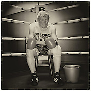 """Michael Tarnoff, 75, of Milwaukee, Wisconsin.<br /> <br /> """"Some of think it's a little crazy to be boxing at my age. I know I'm an old man but even when you're old, you want some excitement and it will keep you in good condition. If you're gonna box, you'd better be in good condition and I think I've stayed in shape.""""<br /> <br /> """"when I was younger, I played football and basketball. In those sports, when you get to a certain age, you can't play anymore. You can't play basketball at 75….but you can box. There's other older guys that have continued to box, so I felt like I could do it.""""<br /> <br /> """"I don't really much worry about getting hurt but I worry about putting on a good performance, which I felt I didn't do tonight, unfortunately, but other bouts I felt like I have done well.""""<br /> <br /> """"I started when I was about 18 years old and I boxed for about four or five years. I made my little comeback when I read about Masters boxing and older guys at Gleason's Gym in New York. I went there, I've boxed there at least a dozen times now since my comeback seven or eight years ago.""""<br /> <br />  DAVID EULITT/The Kansas City Star"""