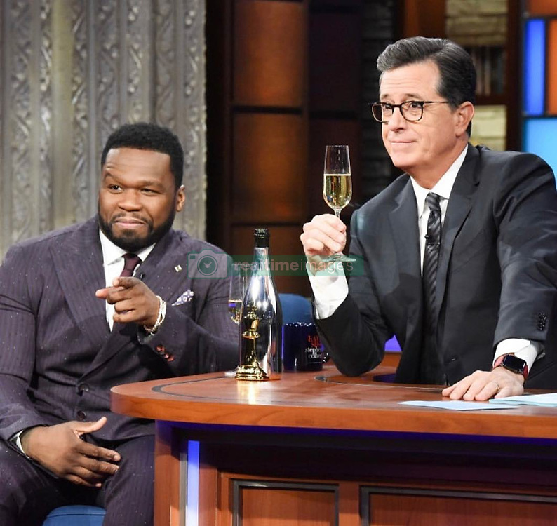 """50 Cent releases a photo on Twitter with the following caption: """"""""This is really not supposed to be this much fun 😉 @colbertlateshow @StephenAtHome #lecheminduroi"""""""". Photo Credit: Twitter *** No USA Distribution *** For Editorial Use Only *** Not to be Published in Books or Photo Books ***  Please note: Fees charged by the agency are for the agency's services only, and do not, nor are they intended to, convey to the user any ownership of Copyright or License in the material. The agency does not claim any ownership including but not limited to Copyright or License in the attached material. By publishing this material you expressly agree to indemnify and to hold the agency and its directors, shareholders and employees harmless from any loss, claims, damages, demands, expenses (including legal fees), or any causes of action or allegation against the agency arising out of or connected in any way with publication of the material."""