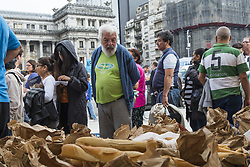 April 25, 2018 - City Of Buenos Aires, City of Buenos Aires, Argentina - INT. 2018 April 25, City of Buenos Aires, Argentina.- Bakers protest in front of the National Congress, City of Buenos Aires, Argentina, giving away five thousands kilos of bread because of the increase on rates and bills as light and gas. Nearly 2 blocks of people wait in line to get some bread. (Credit Image: © Julieta Ferrario via ZUMA Wire)