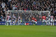 Swansea city players look on as the ball goes in off  Swansea city player Jonathan De Guzman (2nd right) for the 2nd WBA goal. Barclays Premier league, West Bromwich Albion v Swansea city at the Hawthorns stadium in West Bromwich, England on Saturday 9th March 2013.  pic by  Andrew Orchard, Andrew Orchard sports photography,