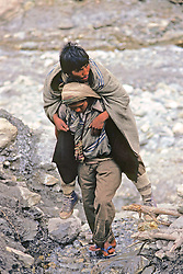 Man Carrying Injured Friend