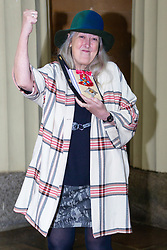 Dame Mary Beard, Professor of Classics, University of Cambridge displays her award For services to the Study of Classical Civilisation following her investiture by Prince William at Buckingham Palace in London. London, December 07 2018.