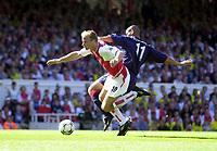 Picture: Henry Browne<br />Date: 13/09/2003<br />Arsenal v Portsmouth  FA Barclaycard Premiership<br /><br />DennisBergkamp of Arsenal is hauled down by Portsmouth's Nigel Quashie