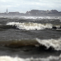Waves crash toward Sullivan's Island from Charleston Harbor on Saturday as Hurricane Matthew moved out of the area. (ANDREW KNAPP/STAFF)