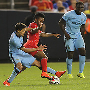 Raheem Sterling, (right), Liverpool, is challenged by Jesús Navas, Manchester City, during the Manchester City Vs Liverpool FC Guinness International Champions Cup match at Yankee Stadium, The Bronx, New York, USA. 30th July 2014. Photo Tim Clayton