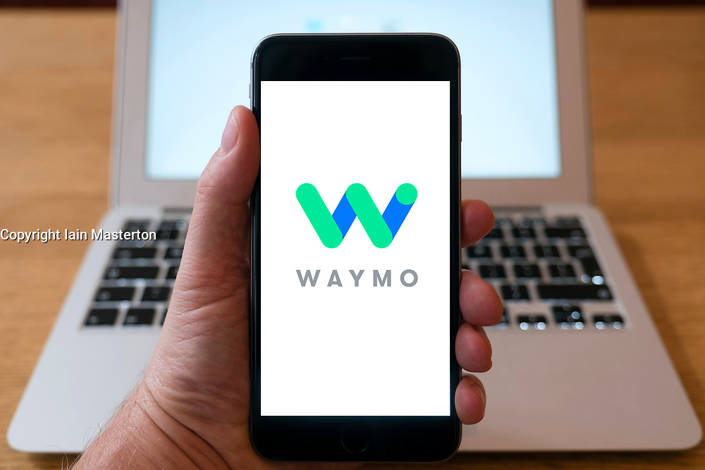 Waymo , formerly the Google self driving project, company logo on  website on smart phone screen.