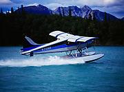 Trail Ridge Air's de Havilland Beaver on step for take off from channel of Hardenburg Bay, Lake Clark, Port Alsworth, Alaska.
