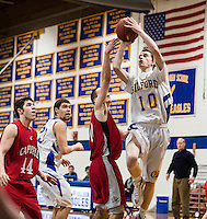 Gilford's Rich Edson goes up for a shot guarded by Campbell's Jacob Morgan during NHIAA Division III quarterfinal tournament action Saturday night.  (Karen Bobotas/for the Laconia Daily Sun)