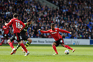 Cardiff city's Fraizer Campbell (10) has a shot at goal. Barclays Premier league match, Cardiff city  v Stoke city at the Cardiff city stadium in Cardiff, South Wales on Saturday 19th April 2014. pic by Andrew Orchard, Andrew Orchard sports photography,