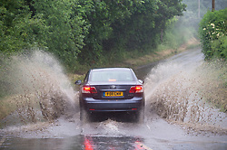 © Licensed to London News Pictures 17/06/2021. Crockenhill, UK. Flood water spray from a car. Torrential rain is causing roads to flood in Crockenhill, Kent. Photo credit:Grant Falvey/LNP