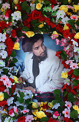 KABUL,AFGHANISTAN - SEPT. 8: A wreath is hung around a poster of Ahmad Shah Massoud September 8, 2002 who was killed one year ago from tomorrow in Kabul, Afghanistan. (Photo by Ami Vitale/Getty Images)