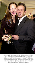 MR JOEL CADBURY and the HON.CAMILLA ASTOR, at a party in London on 7th March 2002.OYD 5
