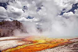 Excelsior Geyser Crater, formerly known as Excelsior Geyser, is a hot spring in the Midway Geyser Basin of Yellowstone National Park in the United States. Excelsior was named by the Hayden Geological Survey of 1871