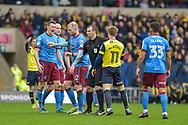 Scunthorpe United Defender, Murray Wallace (5) and Oxford United Forward, Conor McAleny (11) clash during the EFL Sky Bet League 1 match between Oxford United and Scunthorpe United at the Kassam Stadium, Oxford, England on 18 March 2017. Photo by Adam Rivers.